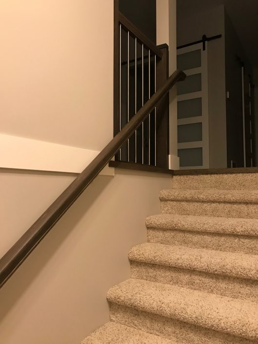 custom hardwood handrail and newel post